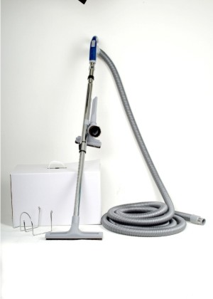 Central Vacuum Cleaner Hose A powerful vacuum unit mounted in a cupboard,